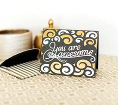 """You Are Awesome Card  You're awesome. Don't forget that. Send the same greeting with this trendy card. I used white and gold vinyl to give the card added dimension. The finished card measures 5"""" x 4"""" and comes with a matching envelope. It uses images from the Cricut® Phrases, Paper Lace, and Classically Modern Cards digital cartridges - all included in the Cricut® subscription.  xoxo, Anna Rose  DIY, created with a Cricut Expolore, creative cards, personal touch, handmade"""