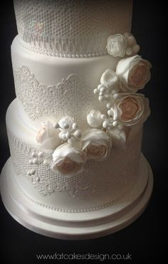 Edible lace wedding cake with soft pastel sugar flowers. Half cascade.