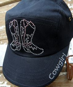 This hat has a distressed finish with intentional rips and tears. It also features beautiful stitching and design. - Rustic Design - Baseball Cap - Embroidery Accents - Adjustable Back - 100% Cotton - One Size Fits Most