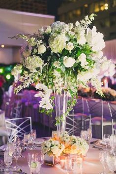 Classically Stunning Arizona Wedding - MODwedding. Tall floral arrangement. White textures floral arrangement.