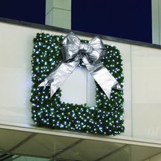 Square commercial Christmas wreath available with various style bows and sizes.  Comes with cool white or warm white LED mini lights.