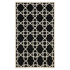 Stylishly anchor your living room or master suite with this lovely flatweave wool rug, showcasing an alluring geometric motif in black and ivory.