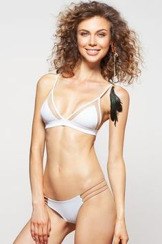 Get more out of the skimpy bikini bottom with the reversible feature since it will be your new favorite bottom. For the complete look match it with Dbrie Swims White Jae Bikini Top.#white