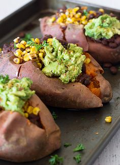 Charred Corn & Black Bean Stuffed Sweet Potatoes - the ultimate comfort food that is nourishing, wholesome, and incredibly delicious! From sprinkleofgreen.com