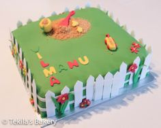 Garden cake with white fence and sandbox
