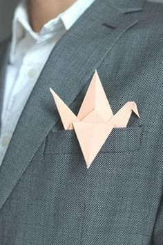 origami paper crane boutonniere in pale pink