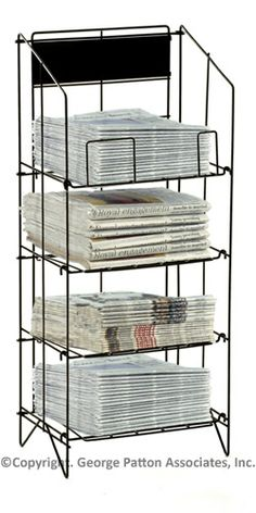 Metal Newspaper Stand that has Four Levels $34