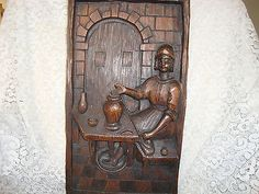 VINTAGE CARVED WOOD WALL HANGING WOMAN SPINNING POTTERY