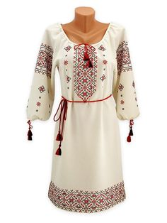 Embroided dress with filigreed ornament in traditional colours
