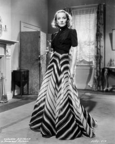 Marlene Dietrich in Tailored Dress with a Long Skirt in Geometric Pattern Photo