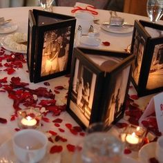 Picture Frame Centerpieces, fabric tape backless frames together, print black and white photos on vellum paper, insert flameless candles