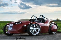 Very cool! ♥♥♥The Campagna V13R  Canadian built, has a Harley-Davidson V-Rod motor and like its brother the T-Rex, its a 3-wheeler. It has one of the lowest ride heights of anything on the road and with a stance 3-inches wider than a Corvette, its next to impossible to flip.