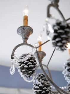 Decor overhead If you have a hanging light fixture or chandelier, attach white-tipped pine cones with slender wire or fishing line for a wintery look. Christmas Mantels, Christmas Holidays, Christmas Decorations, Christmas Ideas, Christmas Crafts, Xmas Ornaments, Holiday Decorating, Christmas Stuff, White Christmas
