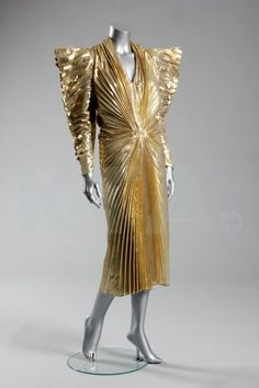 Thierry Mugler pleated cloth of gold evening gown with exaggerated shoulders, circa 1985