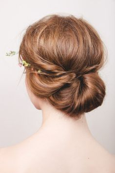 Modern bridal bun - #wedding #hair ideas - follow the tutorial: http://www.weddingandweddingflowers.co.uk/article/1190/wedding-hair-tutorial-the-modern-bridal-bun