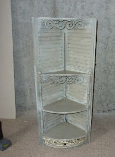 Two shutters, scrap wood, and some pretty iron ornaments= awesome corner shelves #DIY #Corner #Shelves #Ideas