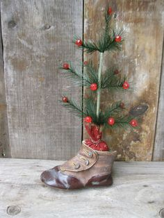 ANTIQUE BABY SHOES WITH SMALL FEATHER TREE.