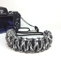 Titanium DSLR Camera safety strap. Easy to wear, tangle free, super strong, and very light. Want one in your favorite colors, or team colors? Hit me up. Get yours today only at www.stupidstraps.com #stupidstraps #straps #wriststrap #strap #camera #550 #strong #digital #titanium #silver #gray #grey #charcoal #black #camo #dslr #safetystrap #safety #custom #handmade #nikon #madetoorder #canon #sony #photographer #photography #photoshoot #photo #camouflage #kingcobra