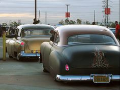 Couple of sweet rides and some pinstriping to top it off.
