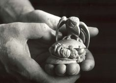 Bill Reid holding his carving, 'The Raven Discovering Mankind in a Clamshell', 1970, which was inspired by the carvings of his Great Uncle, Charles Edenshaw. photo by Ulli Steltzer