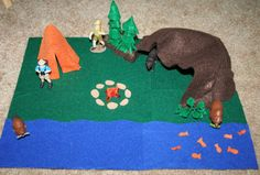 Lots of Felt Playscapes- camping, pond, flower garden, tar pit, volcano, ocean, oil spill, and arctic.