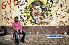 graffiti electoral | ... graffiti depicting Mursi on a wall of the Presidential Palace in Cairo