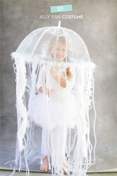 DIY Jelly Fish Costume. #halloween #diyhalloween #diycostume  http://www.stylemepretty.com/living/2014/10/06/diy-halloween-costume-jellyfish/  Photography: Ruth Eileen - rutheileenphotography.com