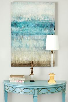 A watery blue abstract art piece feels beachy in a sophisticated way