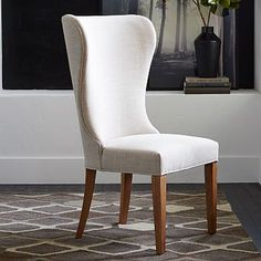 "24""w x 25""d x 41.5""h. Upholstered linen weave fabric in Natural. Almond-stained wood legs. Online/catalog only. Imported."