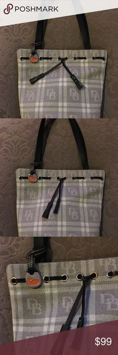 "Dooney & Bourke Plaid Monogram Bucket Bag Beautiful Dooney &Bourke plaid bucket bag in gray and black leather trim.  Mint condition, very light wear if at all.  10"" x 12"" x 5"" Dooney & Bourke Bags Totes"