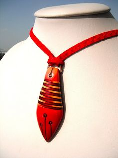 "Polymer Clay pendant on necklace. ""Red Drop"" by Mabcrea Art Cecilia Botton aka Ma-belette, via Flickr. I love how this looks like a tie and also a fish at the same time. What a great new shape for a pendant."