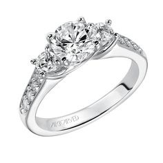 "Brides.com: Three-Stone Engagement Rings. Style 31-V194ERW, ""Natalia"" diamond three-stone engagement ring with round center stones and round accent stones. $2,435, ArtCarvedSee more ArtCarved engagement rings."