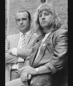 Francis Rossi and Rick Parfitt of rock group Status Quo posed together at London Bridge in London on 19th May 1986