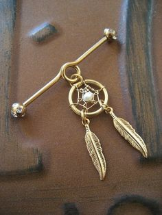 Golden Pearl Dream Catcher Industrial Piercing Barbell Feather Charm Dangle 14g 14 G Gauge Bar. $17.20, via Etsy.