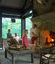 This summer cabin, off Georgia's Lake Burton, boasts an enclosed porch with a large stone fireplace, perfect for gathering around on chilly early summer evenings. More decorating ideas:  40 Amazing Before-and-After Home Makeovers »   The Ultimate Guide to Kitchen Decorating » 21 Creative Window Treatments »