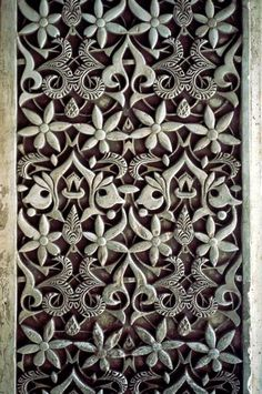 This is stucco and plasterwork rather than tile, but the Arabesque design is gorgeous.     Alhambra, Granada, Spain  Nasrid Dynasty
