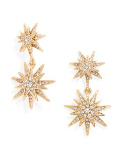 Radiating three-dimensional stars compose this holiday-ready pair of twinkling drop earrings.%0D%0A
