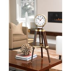 Perfect for the modern country home or nautical theme library, this tripod table top clock is adjustable and offers harmonic 2 triple chime movement. Bronze finish metal case & pendulum with solid hardwood legs . Anniversary Clock, Mantel Clocks, Bulova Watches, Antique Clocks, Modern Country, Home Wall Decor, Tripod Lamp, Rustic Design, Hardwood