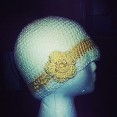 Crochet hat yellow flower