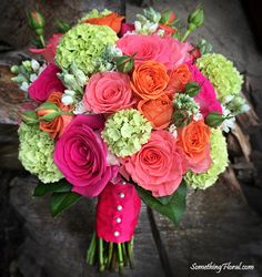 Vibrant, round, hand-tied bridal bouquet of fresh flowers in shades of coral, salmon, orange, electric/hot pink, fuchsia, green, and white. Floral design and Photo: Something Floral (Warren, MI). SomethingFloral.com