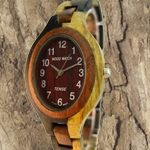 Naturally multi-colored sandalwood creates a eye-popping wooden watch! Wooden Watch, Eye, Watches, Wooden Clock, Wristwatches, Clock