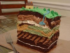Geology cake. All of the layers of the Earth with landforms and other things that would be useful to teach with.
