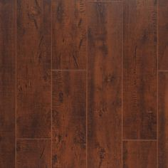 Varnished Walnut, from the Masterpiece Collection by Artisan Floors, featuring 5-inch wide-plank slightly-textured laminate flooring in many exotic and traditional styles and colors.
