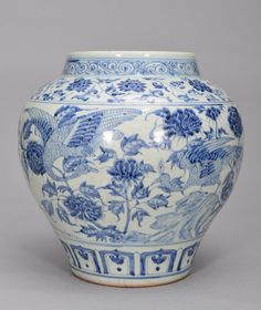 A LARGE OF BLUE AND WHITE JAR, Ming Dynasty. The jar is of wide globular-shaped and the exterior is decorated with many peacocks surrounded by flower blossoms. 14 1/4 in. tall.