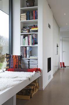 Rhetorical question: who doesn't love a window seat with bookshelf nearby?     via Design Milk: A Retro Modern Prefab: Pavilion 65 by Pavilion Living Photo
