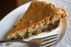 Chocolate Chip Cookie Pie - This pie recipe is my go to dessert recipe! It is easy to throw together and can bake while you are eating dinner--- perfect for a last minute company is coming dessert!