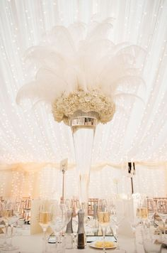 Fabulous feathers create a glamorous effect on this centerpiece of white hydrangeas.