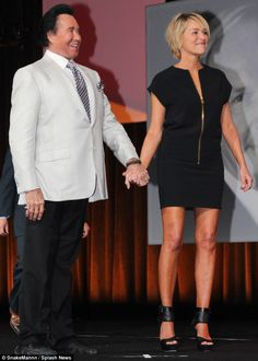 Cute twosome: The Specialist star held hands with Wayne as they shared the Vegas stage...