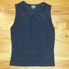 Nike Dri- fit black tank top Nike Black sleeveless top size small (4-6.) Excellent condition. Nike Tops Tank Tops
