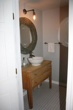 Love the washbasin-style sink. Would love it even more in a full dresser-turned-cabinet stand. Maybe painted bright blue, maybe antiquey and old barn-wood looking.